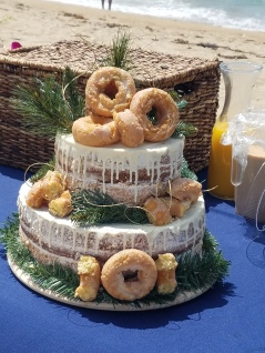 Three Tiered Cake with Doughnuts