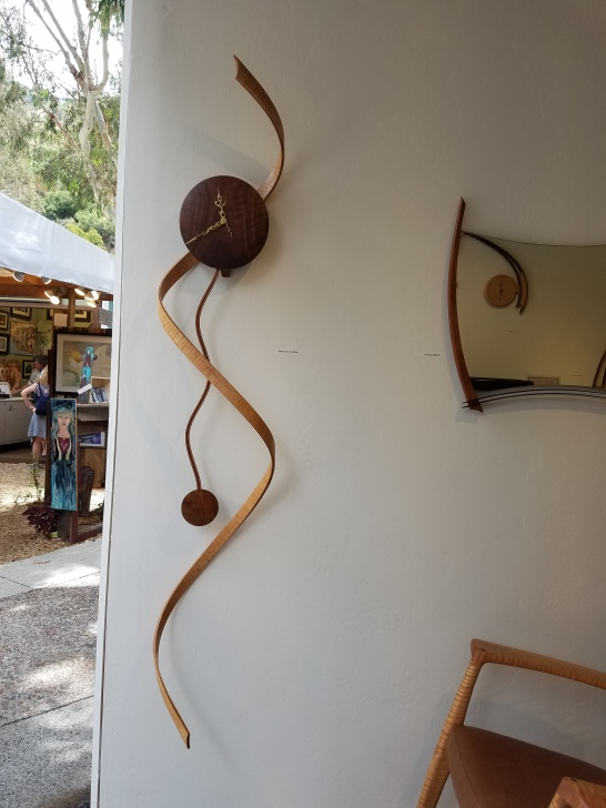 Clock, mirror and chair crafted by hand